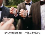 groom and groomsman clang their ... | Shutterstock . vector #746359693