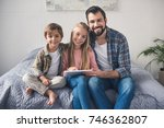 smiling family with tablet... | Shutterstock . vector #746362807