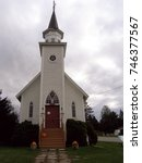 Small photo of Church with seasonal decorations in hamlet of West Brome, Quebec, Canada