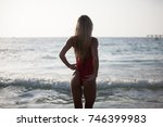 sexy girl in a red bathing suit ... | Shutterstock . vector #746399983