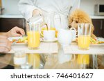 young woman pours coffee into a ... | Shutterstock . vector #746401627