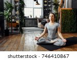 woman practicing home yoga. a... | Shutterstock . vector #746410867
