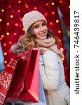 woman shopping for christmas.... | Shutterstock . vector #746439817