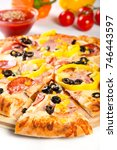 pizza with salami and vegetables | Shutterstock . vector #746443597