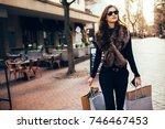 fashionable young woman walking ... | Shutterstock . vector #746467453