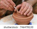 hands of a potter. potter... | Shutterstock . vector #746478133