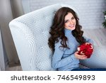 beautiful woman with a gift in... | Shutterstock . vector #746549893