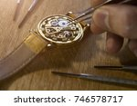 watchmaker is repairing the... | Shutterstock . vector #746578717