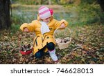the girl is holding two baskets ... | Shutterstock . vector #746628013