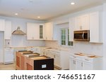 installing new induction hob in ... | Shutterstock . vector #746651167