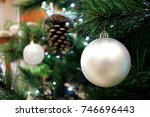 pearl xmas bauble on tree | Shutterstock . vector #746696443