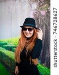 beautiful girl drinking coffee... | Shutterstock . vector #746728627