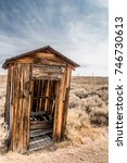 Old Wooden Outhouse In A Deser...