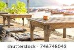 beach and wooden decoration... | Shutterstock . vector #746748043