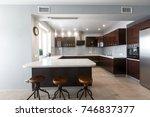 brand new modern kitchen. open...   Shutterstock . vector #746837377