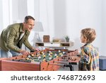 side view of father and son... | Shutterstock . vector #746872693