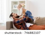 family  parenthood and people... | Shutterstock . vector #746882107
