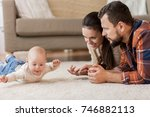 family  parenthood and people... | Shutterstock . vector #746882113
