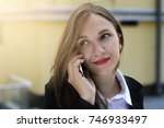 business woman with phone | Shutterstock . vector #746933497