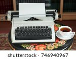 a typewriter and tea on an...   Shutterstock . vector #746940967