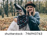 woman and her dog outdoor  | Shutterstock . vector #746943763