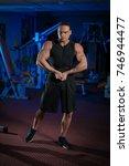 young male athlete bodybuilder... | Shutterstock . vector #746944477