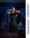 young male athlete bodybuilder... | Shutterstock . vector #746944507
