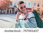 man in shopping. smiling man... | Shutterstock . vector #747001657