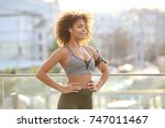 sporty african american woman... | Shutterstock . vector #747011467