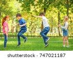 cute little children jumping... | Shutterstock . vector #747021187