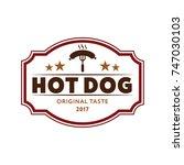 hotdog logo vintage style. flat ... | Shutterstock .eps vector #747030103