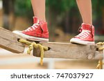 cute girl climbing in adventure ... | Shutterstock . vector #747037927