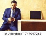 texting to colleague  confident ... | Shutterstock . vector #747047263