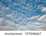 white cloud and blue sky in the ... | Shutterstock . vector #747048667