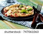 fluffy omelet with tomatoes and ... | Shutterstock . vector #747061063