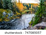 autumn mountain forest river in ... | Shutterstock . vector #747085057