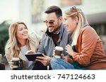 group of smiling friends with...   Shutterstock . vector #747124663