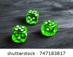 risk concept   playing dice at... | Shutterstock . vector #747183817