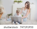 happy mother and child together ... | Shutterstock . vector #747191953