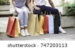 young couple with shopping bags ... | Shutterstock . vector #747203113