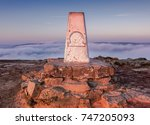 Small photo of Cloud inversion on top of mountain with view across the country