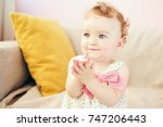 Small photo of little girl claps her hands smiling