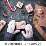 woman hands in mittens packing... | Shutterstock . vector #747209107