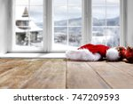 desk and winter window  | Shutterstock . vector #747209593