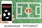 smartphone and soccer stadium... | Shutterstock . vector #747218317