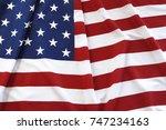 closeup of rippled american flag | Shutterstock . vector #747234163