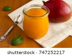 puree with mango on the napkin | Shutterstock . vector #747252217