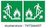 emergency fire exit upwards... | Shutterstock .eps vector #747266437