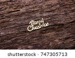 the inscription merry christmas ... | Shutterstock . vector #747305713