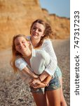 two sisters on the beach with... | Shutterstock . vector #747317233